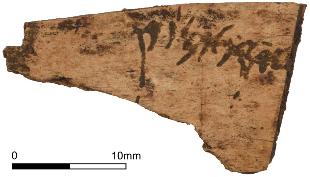 A bone plaque with Roman cursive text (c) A14C2H courtesy of MOLA Headland Infrastructure
