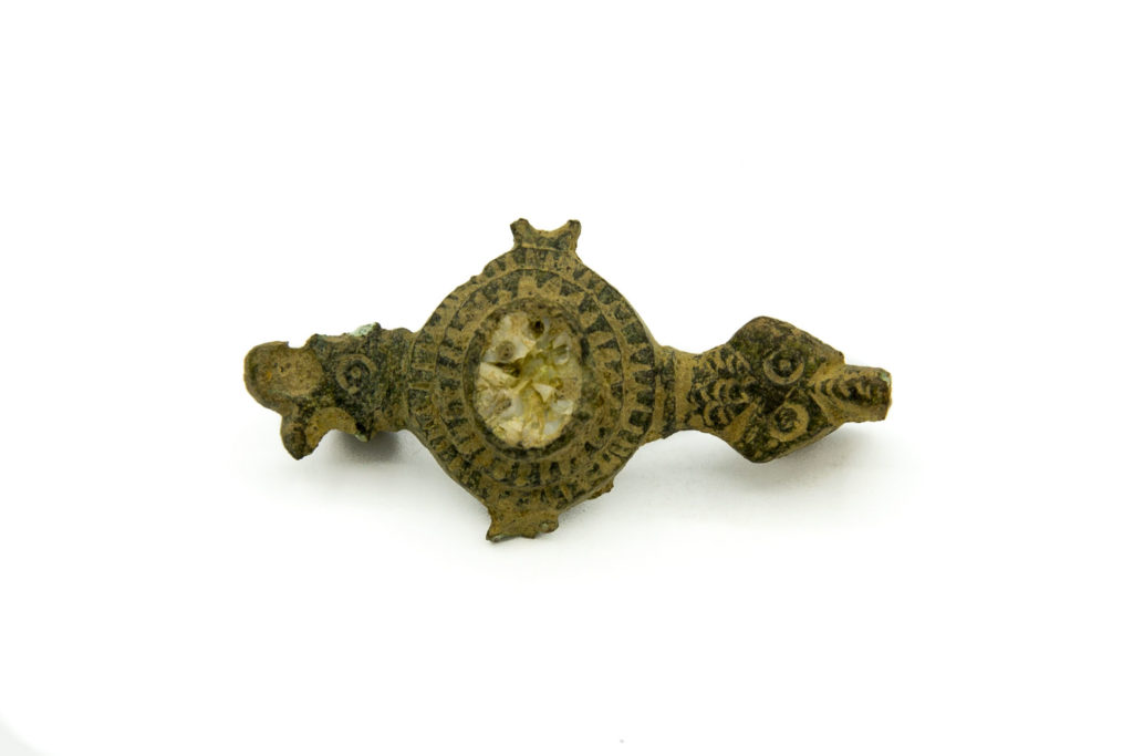Continental Roman copper-alloy plate brooch with enamelled decoration and animal head terminals, 2nd century (c) Highways England, courtesy of MOLA Headland Infrastructure