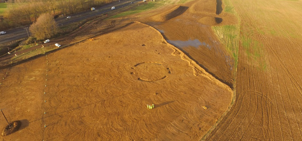 Aerial photo of a circular Bronze Age burial ground and nearby Saxon building on A14C2H (c) A14C2H courtest of MOLA Headland Infrastructure