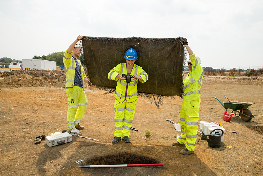 A14C2H Community Dig volunteer Manuela taking a photo (c) Highways England, courtesy of MOLA Headland Infrastructure
