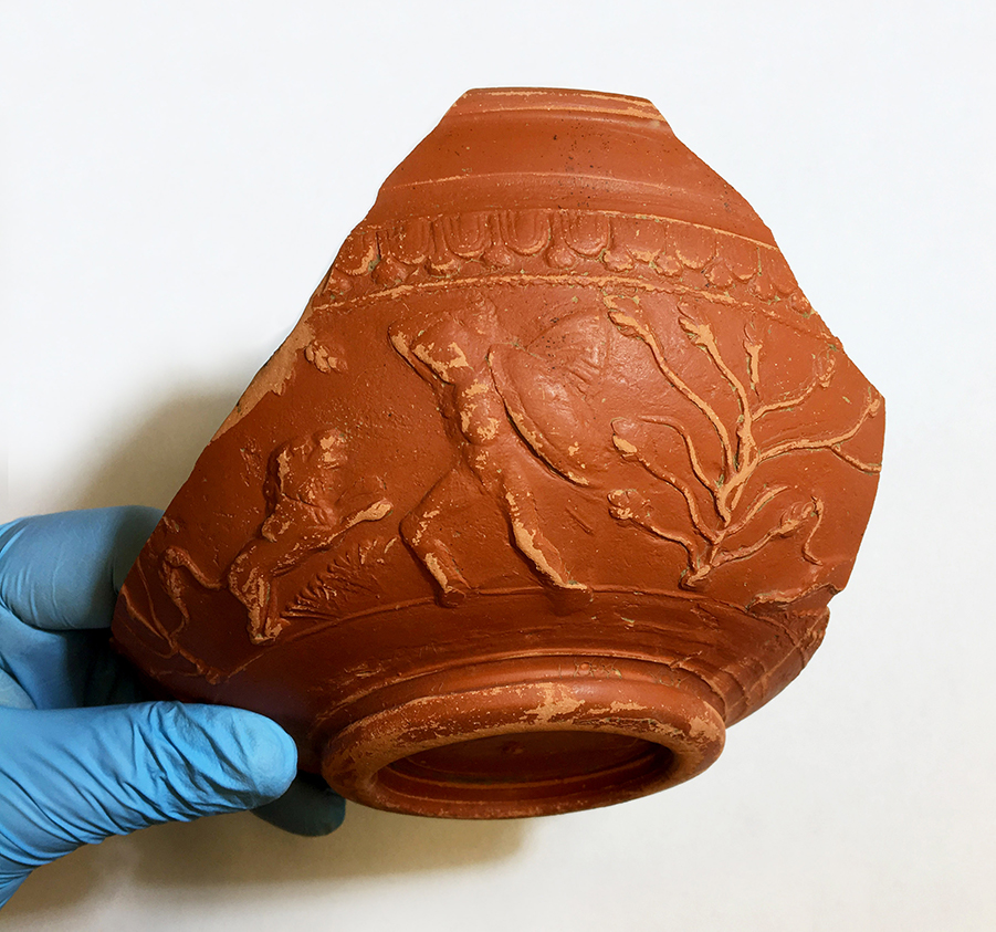 Samian ware decorated with lion fight scene (c) Highways England courtesy of MOLA Headland Infrastructure