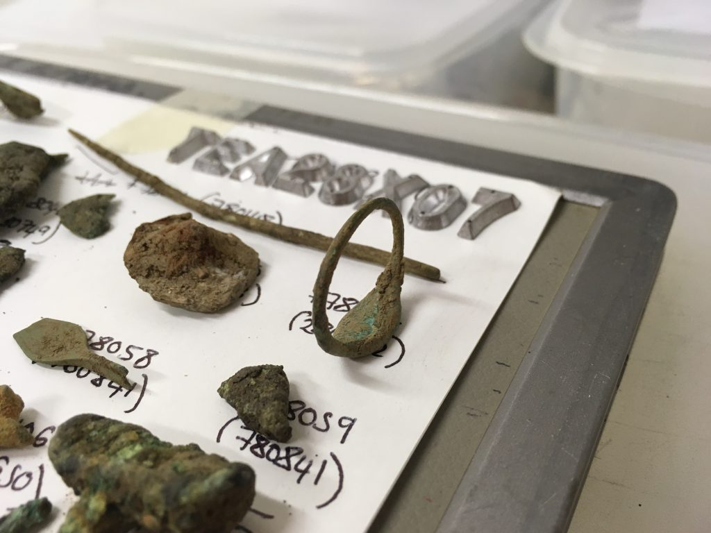 Close up of metal finds laid out for x-ray (c) Highways England courtesy of MOLA Headland Infrastructure