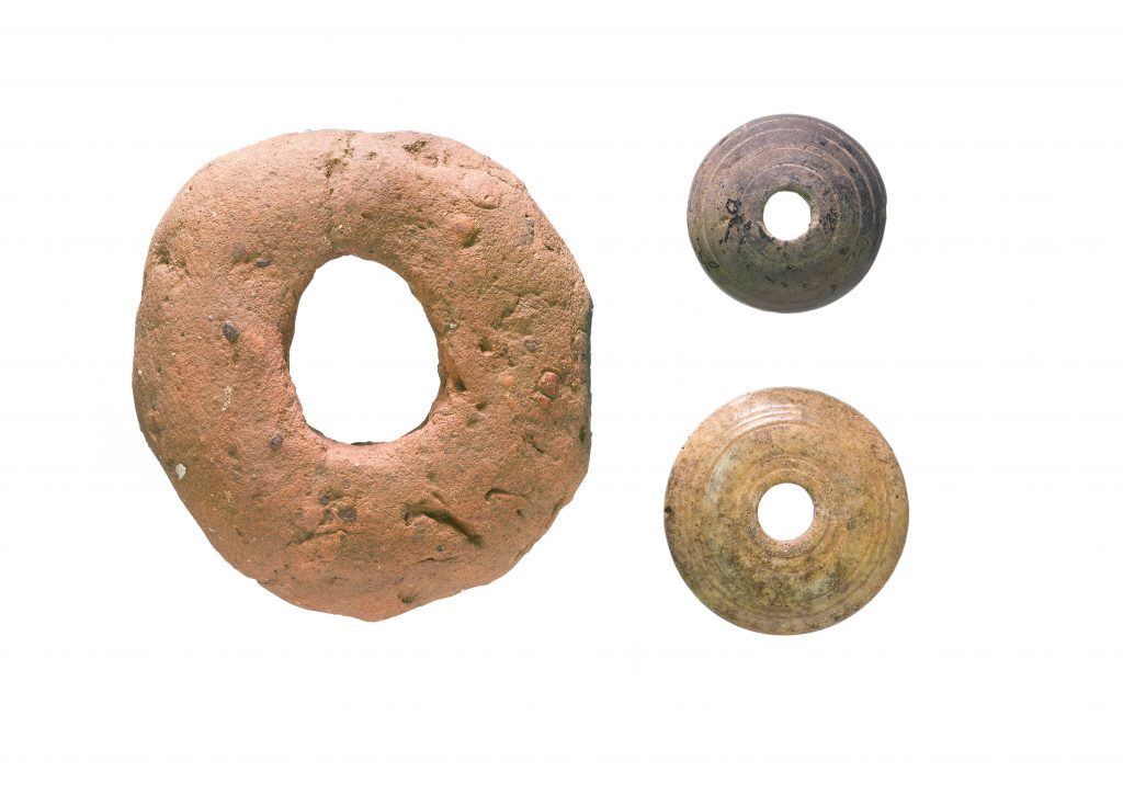 Left- Anglo-Saxon clay loomweight. Right - Stone and bone spindle whorls - both discovered on A14C2H (c) Highways England courtesy of MOLA Headland